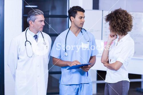 Doctor having a discussion with colleagues