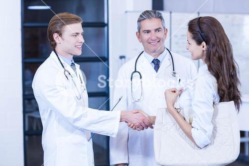 Doctor shaking hands with colleague