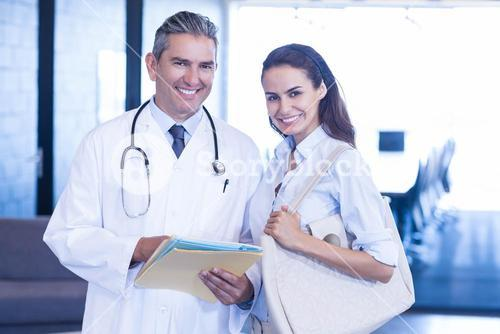 Doctor and colleague looking at camera
