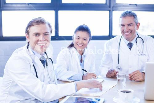 Medical team smiling at conference room
