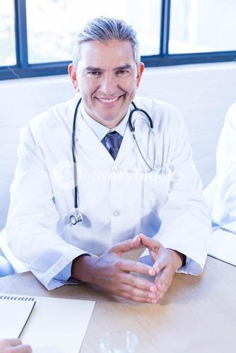 Doctor smiling in conference room