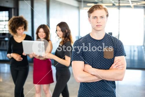 Man looking at camera with arms crossed
