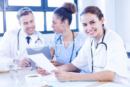 Female doctor meeting with colleagues