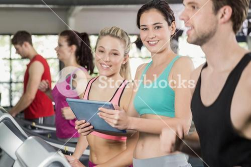Athletic women looking at tablet