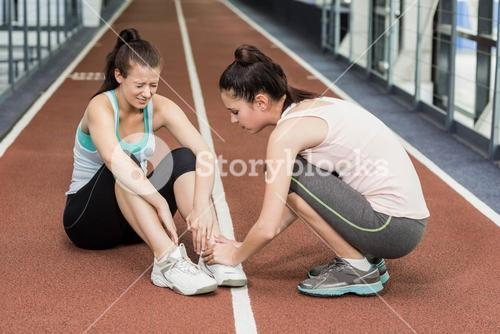 Fit woman having an ankle pain
