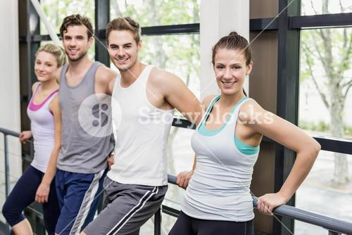 Fit people posing together