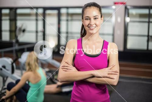 Sportswoman with crossed arms