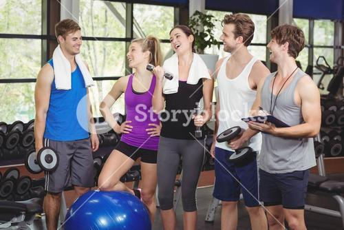 Fit people with sports equipment