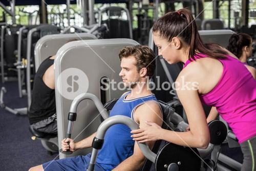Trainer woman helping athletic man