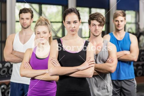 Fitness class with crossed arms