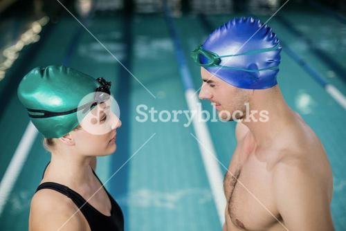 Couple in swimsuits looking at each others