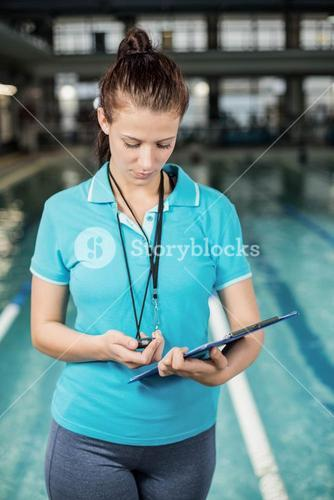 Trainer woman holding a clipboard