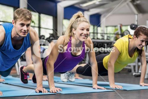 Fit people in plank position
