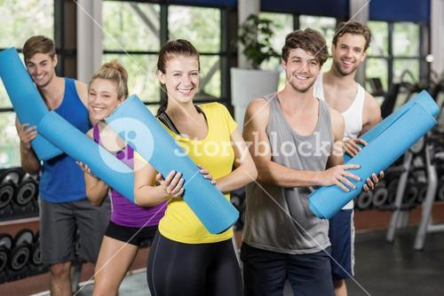 Group of people with fitness mat