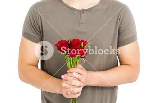 Mid section of man holding bunch of red roses
