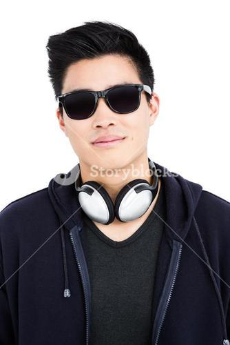 Young man in sunglasses and headphones