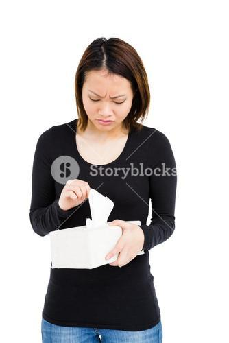 Woman taking a tissue from tissue box