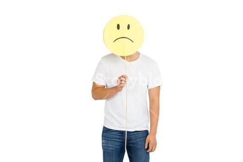 Man holding sad smiley face
