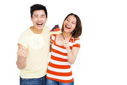 Excited couple holding flag