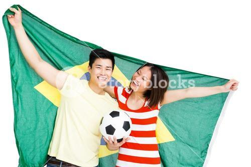 Couple holding brazil flag