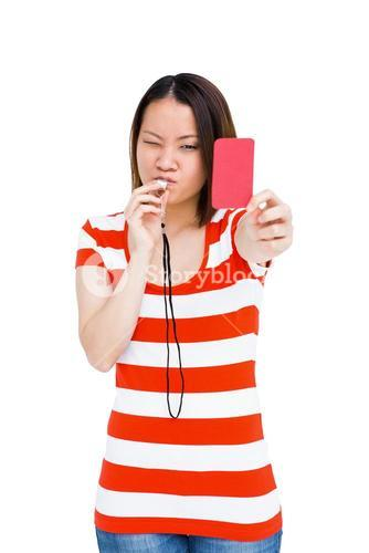 Young woman whistling and showing red card