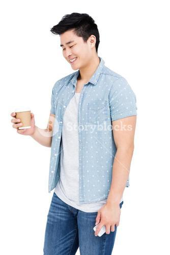 Young man holding a disposable cup