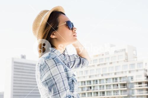 Woman wearing sunglasses and a hat