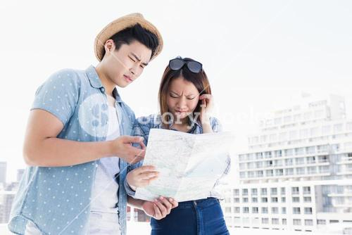 Young couple looking at map for direction