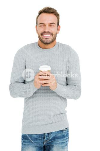 Young man holding disposable cup