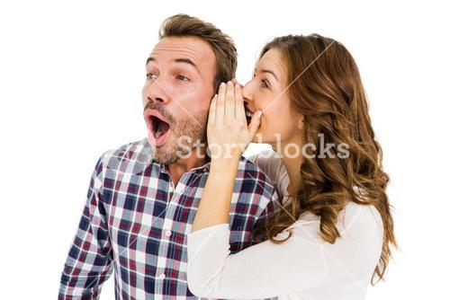 Woman whispering into mans ears