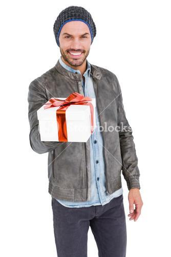 Happy young man holding gift