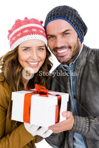 Happy young couple holding gift