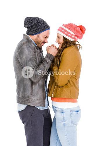 Young couple in warm cloth standing face to face and shivering