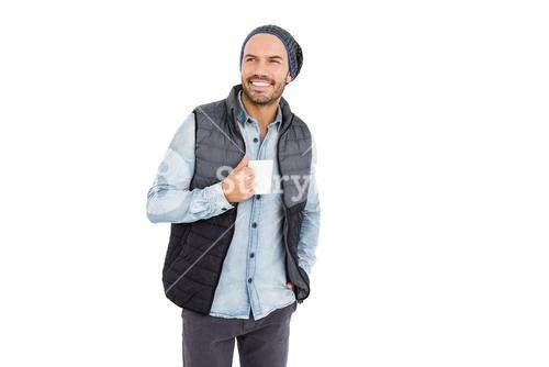 Happy young man holding coffee mug