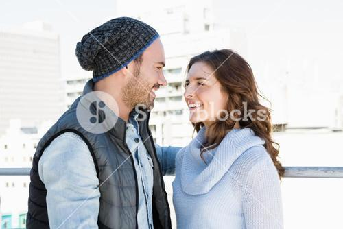 Happy young couple standing face to face