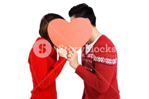 Young couple holding heart