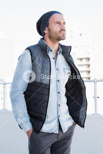 Confident young man wearing beanie hat and jacket