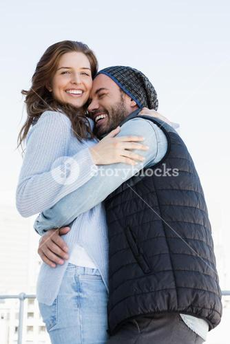 Happy couple cuddling each other