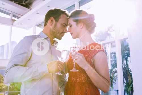 Young couple toasting glasses of champagne