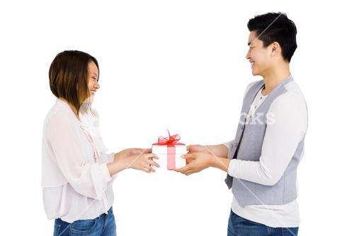 Young man giving a present to woman
