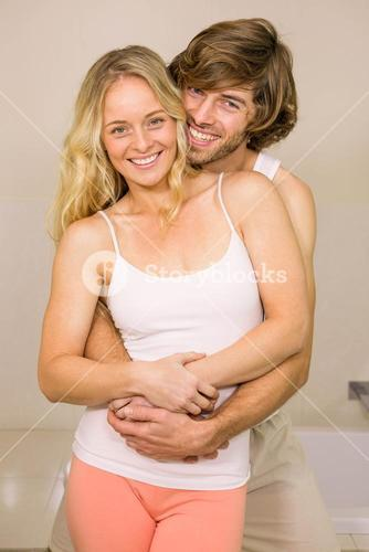 Cute couple embracing in the bathroom