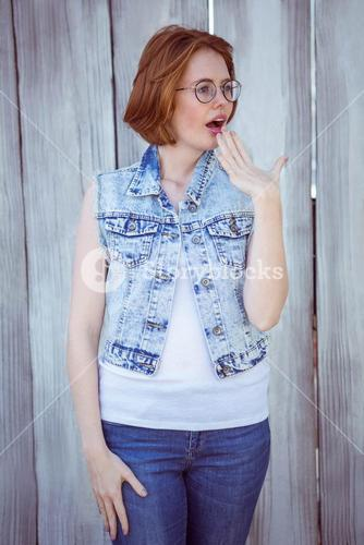shocked hipster woman looking away from the camera
