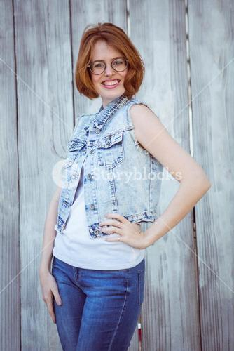 smiling hipster woman her hand on her hip