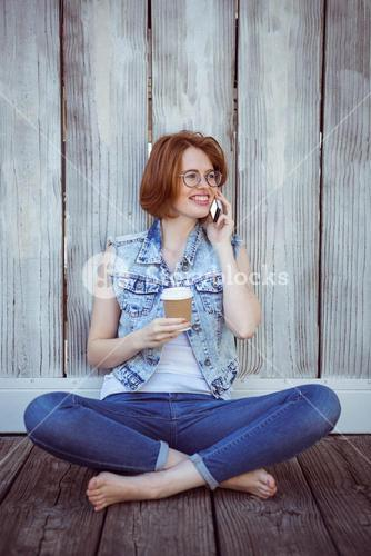 smiling hipster woman sitting on the phone
