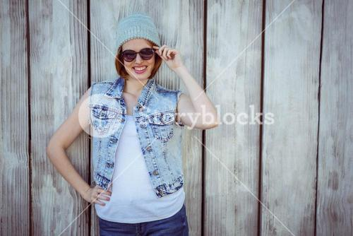 smiling hipster woman wearing a beanie hat