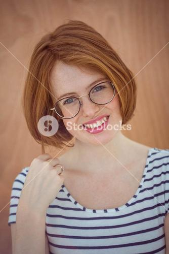 smiling hipster woman wearing glasses