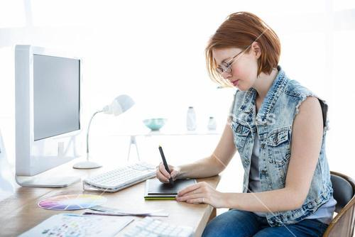 hipster businesswoman drawing on her tablet