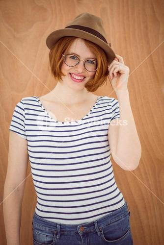 smiling hipster woman wearing a trilby