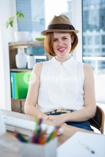 smiling hipster business woman wearing a trilby