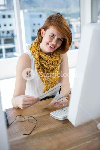 smiling hipster business woman looking at colour swatches